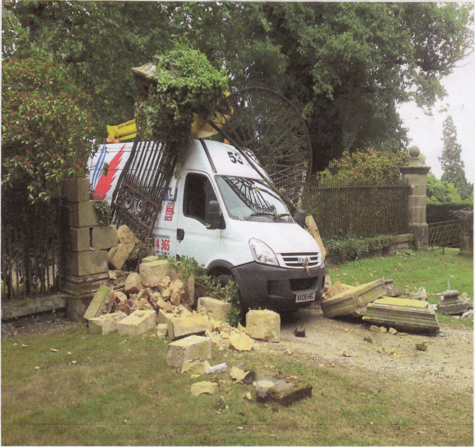 Van destroyed gate & stone piers