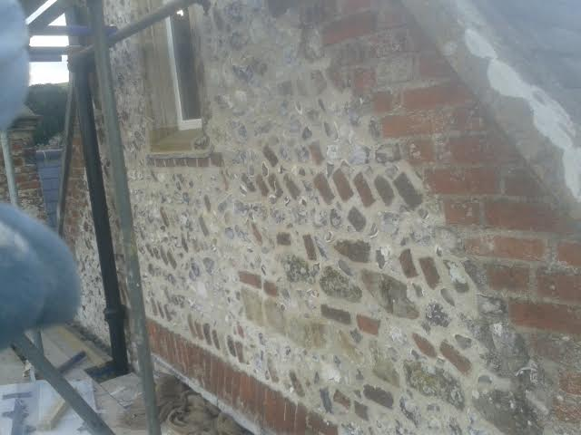 Brickwork & flintwork repair to gable end